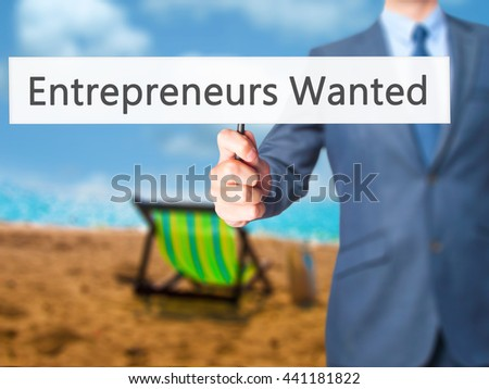 Entrepreneurs Wanted - Businessman hand holding sign. Business, technology, internet concept. Stock Photo - stock photo