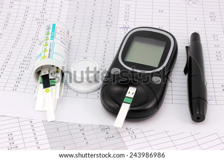 Entries in blood glucose levels and blood glucose meter - stock photo
