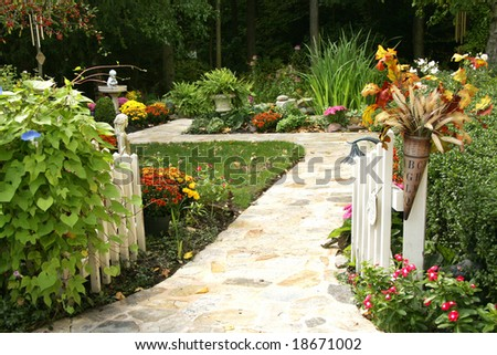 Entry into an amazing backyard filled with fall flowers