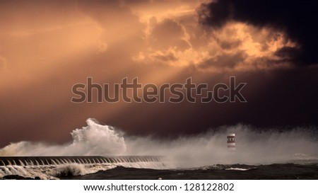 Entry of river Douro during a heavy storm at sunset - enhanced sky - stock photo