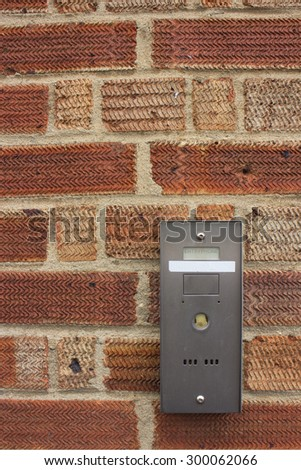 entry phone on a brick wall - stock photo