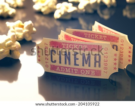Entry ticket to the cinema with popcorn around. Clipping path included. - stock photo