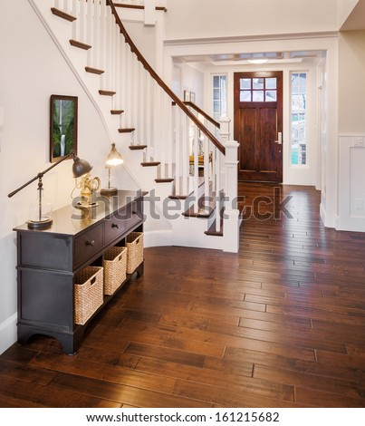 Entryway and Stairs in New Luxury Home - stock photo