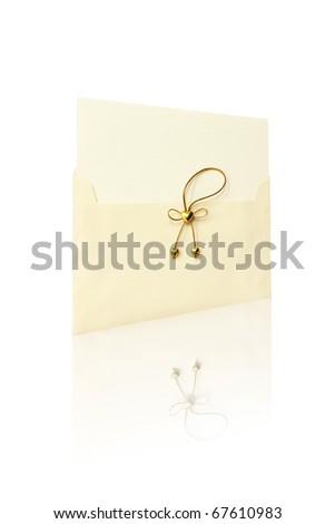Envelope and mail wedding invitations, golden heart. - stock photo