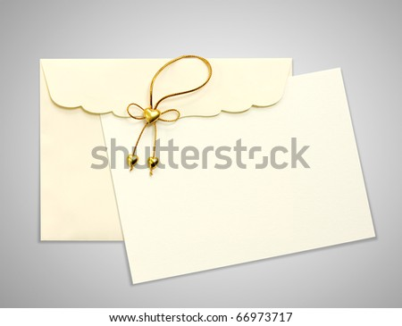 Envelope and mail wedding invitations, golden heart, on gray blackground - stock photo