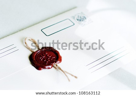 Envelope and wax seal - stock photo