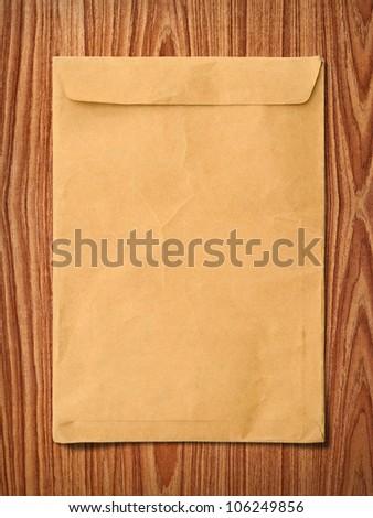 Envelope documents on vintage wood - stock photo