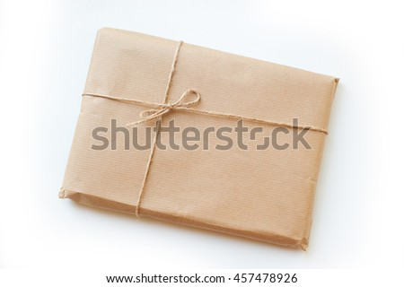 envelope kraft paper tied with string on a white background - stock photo