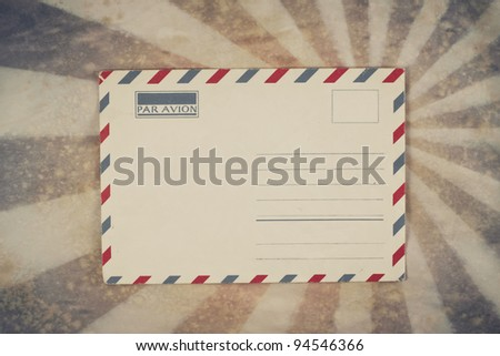 Envelope on sunburst grunge retro background
