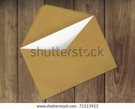 Envelope on wood - stock photo