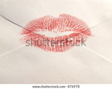 envelope sealed with a lipstick kiss - stock photo