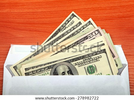 Envelope With a Money on the Table closeup - stock photo