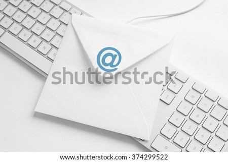 Envelope with at Symbol, concept of E-Mail - stock photo
