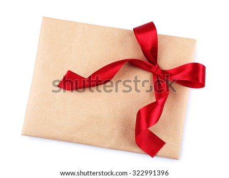 Envelope with bow isolated on white - stock photo