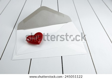 Envelope with red heart for valentine day - stock photo