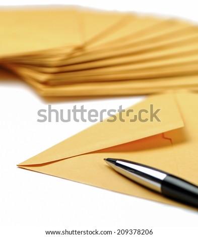 Envelopes and pen on white background - stock photo