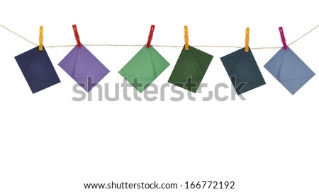 Envelopes Hanging on string clothes line cord with Clothespins isolated on white background