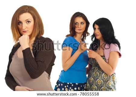 Envious two women gossip about their friend against white background - stock photo