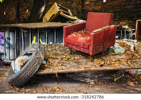 Envirnmental problem related with unrecycled garbage left on the street - stock photo