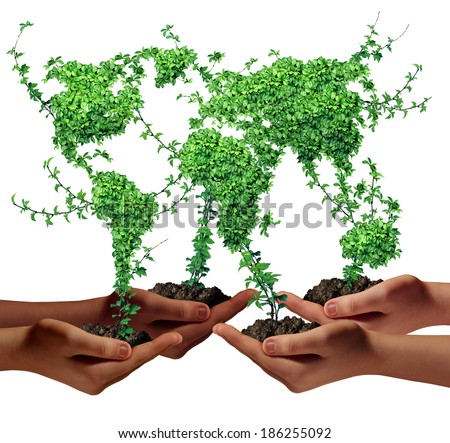 Environment community and business development concept as a group of global ethnic people hands holding green plants with leaves shaped as the world as a metaphor for a growing international economy. - stock photo