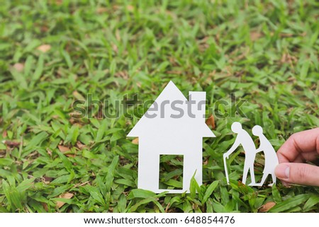 Environment concept, paper old man on green grass background.