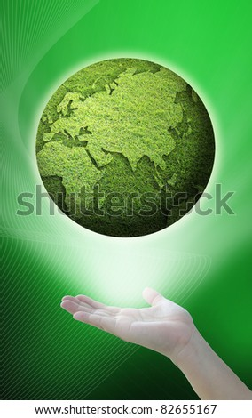 environment idea from green globe over the hand.
