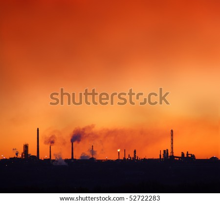 environment pollution - red sky over petrochemical factory chimneys