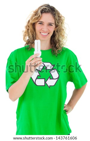 Environmental activist holding a light bulb on white background - stock photo