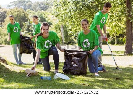 Environmental activists picking up trash on a sunny day - stock photo