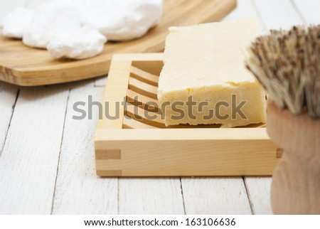 environmental cleansers on white wood background