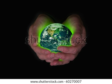 Environmental concept for humanity's responsibility and capacity to care for the planet.  Earth image public domain courtesy http://earthobservatory.nasa.gov/ - stock photo