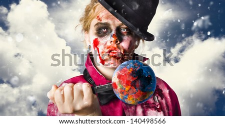 Environmental concept of a zombie stabbing a globe of the world with blood stains when killing the planet with global pollution and destruction - stock photo
