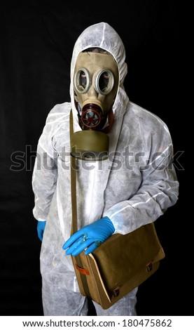 Environmental disaster. Man in gas mask. - stock photo