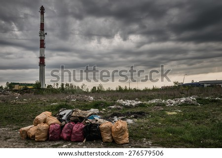 Environmental pollution. Litter, dirty air,  industry cause ecological problem. - stock photo