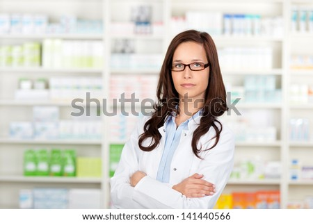 Environmental Portrait of a medical personnel or doctor in pharmacy - stock photo
