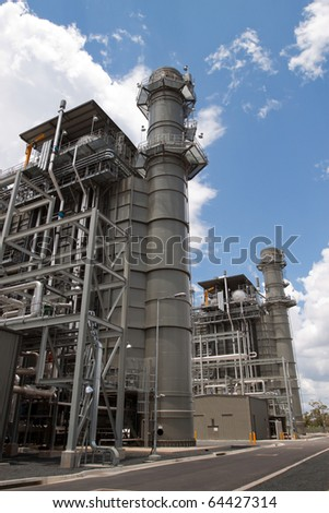 Environmentally advanced technology using methane gas to produce low greenhouse emission electricity.  Clean energy production with copy space.  Vertical image. - stock photo