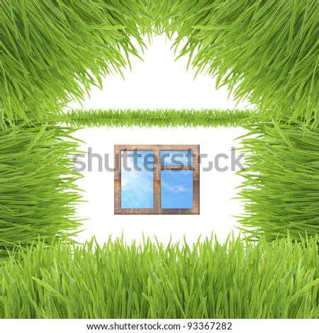 Environmentally friendly house made up of grass isolated on white background - stock photo