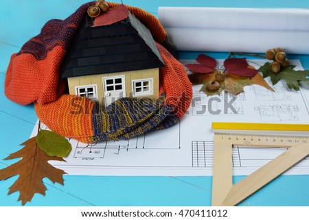 environmentally friendly warm home wrapped in a soft comfortable scarf. Concept