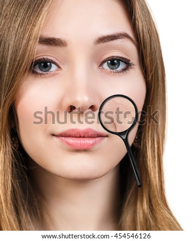 Eoman with magnifying glass showing aging skin