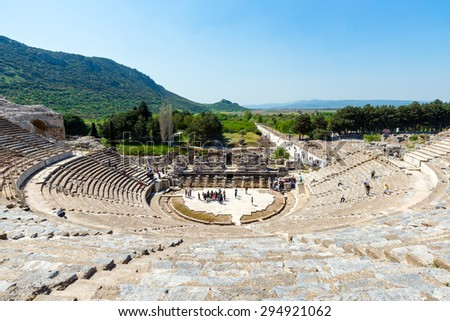 EPHESUS, TURKEY - APRIL 13 : Tourists on Amphitheater (Coliseum) in Ephesus Turkey on April 13, 2015. Ephesus contains the ancient largest collection of Roman ruins in the eastern Mediterranean. - stock photo