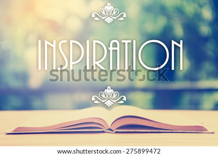 Epigraph over the opened book with elegant ornament - Inspiration -  Positive thinking concept - motivating set - stock photo