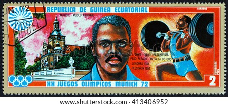 """EQUATORIAL GUINEA - CIRCA 1972: A stamp printed in Equatorial Guinea from the """"Olympic games, Munich"""" issue shows John Henry Davis (1921-1984) and Bavarian National Museum, circa 1972. - stock photo"""