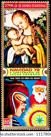 EQUATORIAL GUINEA  - CIRCA 1972:  A stamp printed in Equatorial Guinea shows a painting of the Virgin Mary holding Jesus by Lucas Cranach and Santa Clause, a girl and a Christmas ornament, circa 1972