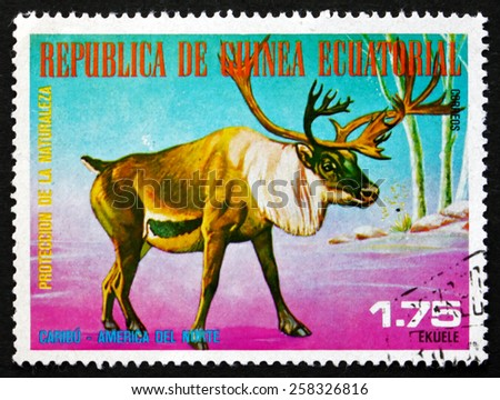 EQUATORIAL GUINEA - CIRCA 1977: a stamp printed in Equatorial Guinea shows Caribou, Rangifer Tarandus, Wild Animal of the North America, circa 1977 - stock photo
