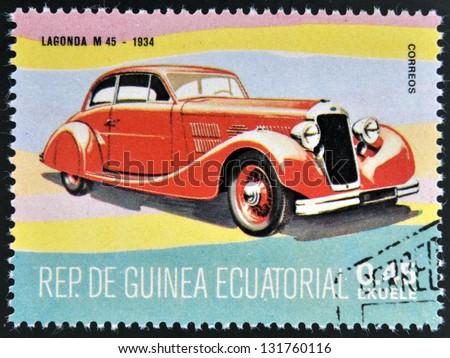 EQUATORIAL GUINEA - CIRCA 1974: A stamp printed in Guinea dedicated to vintage cars, shows Lagonda M 45, 1934, circa 1974 - stock photo