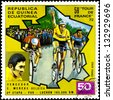 "EQUATORIAL GUINEA - CIRCA 1972: stamp printed in Equatorial Guinea shows cyclists and portrait of Edouard Louis Joseph Merckx, with inscription and name of series ""59 Tour de France, 1972"", circa 1972 - stock photo"