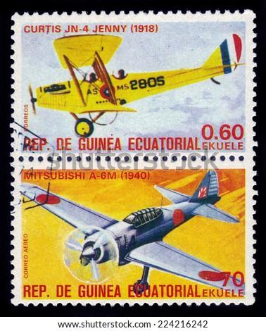 Equatorial Guinea, Republic - CIRCA 1979: A stamp printed in Equatorial Guinean shows retro airplanes Curtis JN 4 Jenny and Mitsubishi A-6M, circa 1979 - stock photo