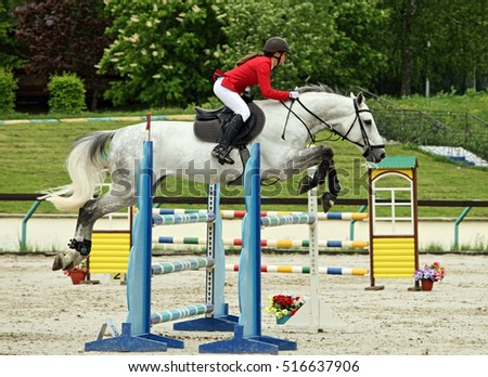 Equestrian girl horseback jumping obstacle