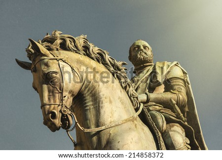 Equestrian statue of Cosimo I de' Medici on the Piazza della Signoria, by Giambologna. Florence, Italy. The look and texture of an old vintage postcard. - stock photo