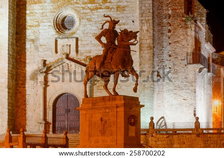 Equestrian statue of Francisco Pizarro in Trujillo at night. Trujillo is a famous town in the province of Caceres, Extremadura, Spain - stock photo